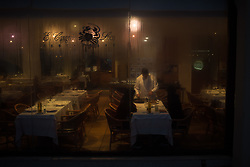 November 18, 2018 - Barcelona, Catalonia, Spain - In a restaurant of Barcelona a waiter serves paella to customers as rain falls outside. (Credit Image: © Jordi Boixareu/ZUMA Wire)