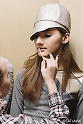 PROVIDENCE, RI - FEB 13: StyleWeek NorthEast's Creative Director for Makeup Holly Dalton applies finishing touches to makeup prior to the Stetkewicz show as part of StyleWeek NorthEast on February 13, 2015 in Providence, Rhode Island. (Photo by Cat Laine)