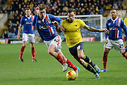 Oxford United striker Chris Maguire and Carlisle United midfielder Antony Sweeney tussle during the Sky Bet League 2 match between Oxford United and Carlisle United at the Kassam Stadium, Oxford, England on 12 December 2015. Photo by Alan Franklin.