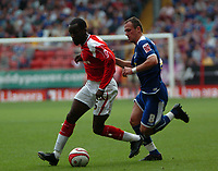 Photo: Tony Oudot.<br /> Charlton Athletic v Leicester City. Coca Cola Championship. 22/09/2007.<br /> Chris Powell of Charlton goes past Radostin Kishishev of Leicester City