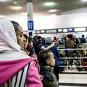 Hailù and his mother at Addis Ababa airport, in the queue for check-in