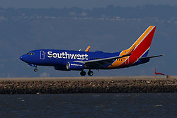 Boeing 737-7H4 (N954WN) operated by Southwest Airlines landing at San Francisco International Airport (KSFO), San Francisco, California, United States of America