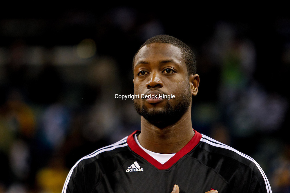 October 13, 2010; New Orleans, LA, USA; Miami Heat shooting guard Dwyane Wade (3) stands for the national anthem prior to tip off of a preseason game against the New Orleans Hornets at the New Orleans Arena. The Hornets defeated the Heat 90-76. Mandatory Credit: Derick E. Hingle