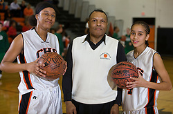 Charlottesville center Shalita Brown (50) and guard Shawntae Payne (4) with head coach Harry Terrell.  Brown and Payne were honored with special balls signifying 1,000 point careers. The Charlottesville High School Lady Black Knights defeated the William Monroe High School Dragons 48-45 in girls basketball at the CHS Gymnasium in Charlottesville, VA on December 19, 2008.  (Special to the Daily Progress / Jason O. Watson)