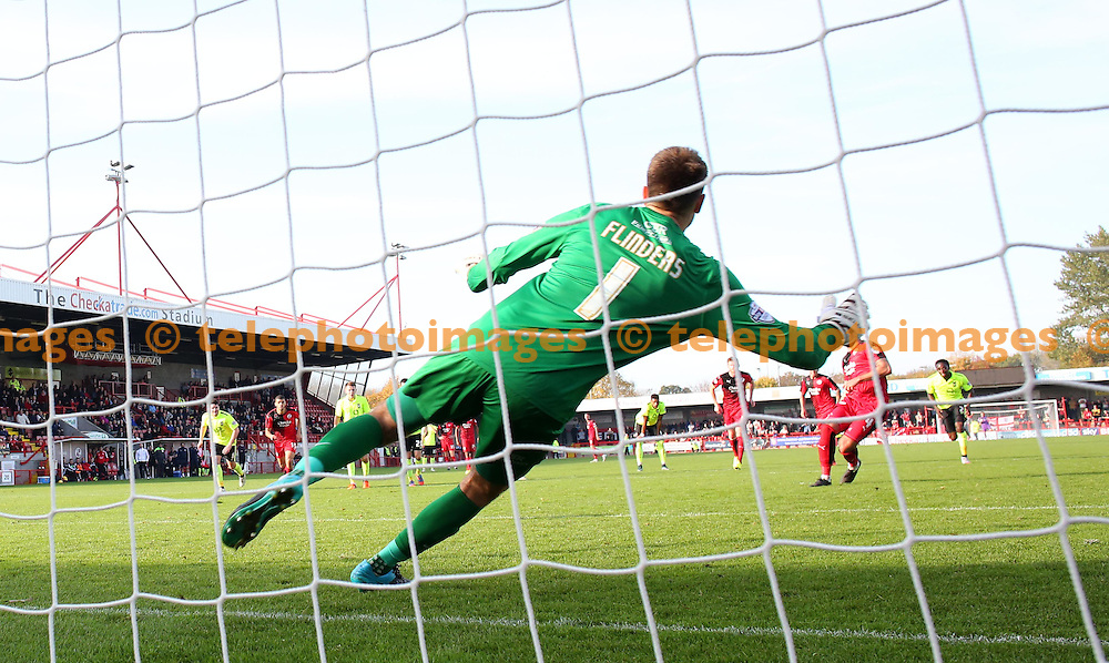 Simon Walton's penalty kick sends York keeper Scott Flinders the wrong way during the Sky Bet League 2 match between Crawley Town and York City at the Checkatrade.com Stadium in Crawley. October 31, 2015.<br /> James Boardman / Telephoto Images<br /> +44 7967 642437