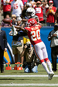 Los Angeles Chargers wide receiver Mike Williams (81) leaps in the air as he tries to catch a failed two point conversion attempt in the end zone while covered by Kansas City Chiefs cornerback Steven Nelson (20) during the 2018 regular season week 1 NFL football game against the Kansas City Chiefs on Sunday, Sept. 9, 2018 in Carson, Calif. The Chiefs won the game 38-28. (©Paul Anthony Spinelli)