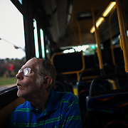 Jimmy Davis peers out the window of the Route 19 Metrobus during his commute to work at the Austin Lighthouse for the Blind in South Austin on October 1, 2014, in Austin, TX.