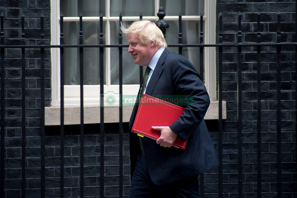 June 15, 2017 - London, England, United Kingdom - Secretary of State for Foreign and Commonwealth Affairs Boris Johnson departs Downing Street, London on June 15, 2017. Prime Minister Theresa May is due to hold a series of meetings with the main Northern Ireland political parties today to allay mounting concerns over a government deal with the DUP in the wake of the UK general election. (Credit Image: © Alberto Pezzali/NurPhoto via ZUMA Press)