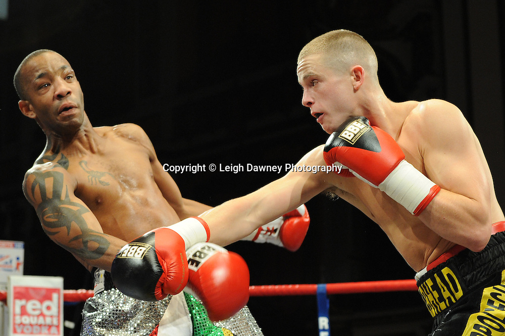 Karl Place (black shorts) defeats Michael Grant for a 6 x 3 min round Light Welterweight contest at Olympia, Liverpool on the 11th June 2011. Frank Maloney Promotions.Photo credit: Leigh Dawney 2011