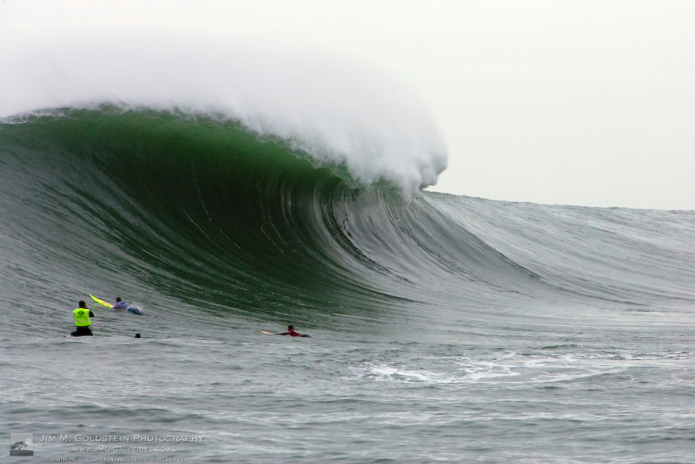 A giant wave passes a heat of surfers at the Mavericks Surf Contest on January 12 2008 at Half Moon Bay