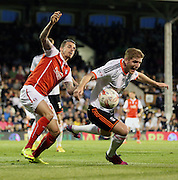 Matt Derbyshire challanging Michael Turner, Rotherham, pressure during the Sky Bet Championship match between Fulham and Rotherham United at Craven Cottage, London, England on 15 April 2015. Photo by Matthew Redman.