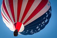 A hot air balloon with American flag motif lifts off during the annual Hot Air Balloon Rodeo in Steamboat Springs, Colorado.