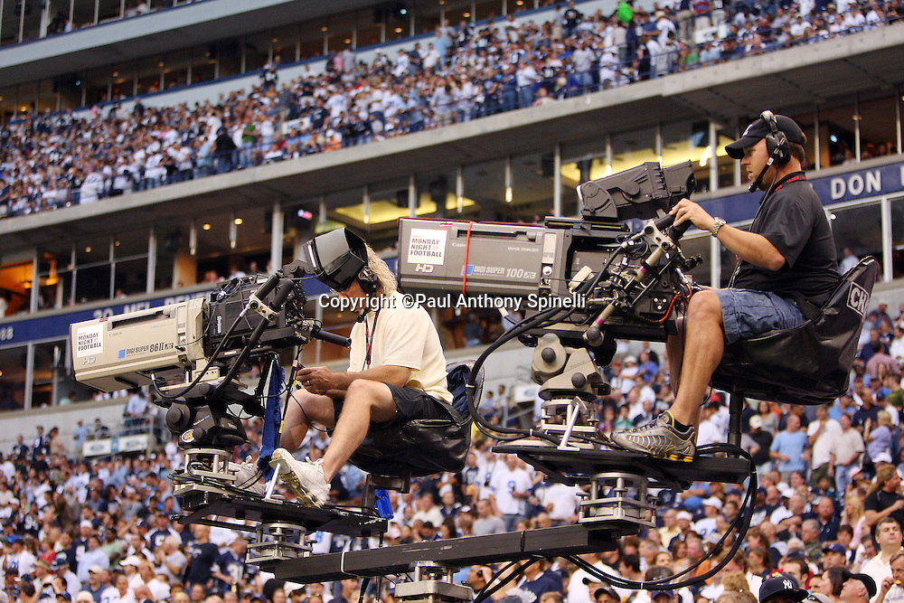 IRVING, TX - SEPTEMBER 15:  Sideline television cameramen are ready atop a moving shooting platform at the Dallas Cowboys game against the Philadelphia Eagles at Texas Stadium on September 15, 2008 in Irving, Texas. The Cowboys defeated the Eagles 41-37. ©Paul Anthony Spinelli