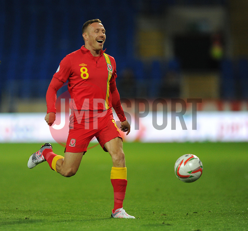 Craig Bellamy of Wales laughs as he fails to catch a lose ball. - Photo mandatory by-line: Alex James/JMP - Tel: Mobile: 07966 386802 11/10/2013 - SPORT - FOOTBALL - INTERNATIONAL - Cardiff - Wales V Macedonia - WORLD CUP 2014 QUALIFYING - GROUP A