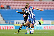 Wigan Athletic defender Dan Burn (33) and Brighton & Hove Albion midfielder Oliver Norwood (21) during the EFL Sky Bet Championship match between Wigan Athletic and Brighton and Hove Albion at the DW Stadium, Wigan, England on 22 October 2016.