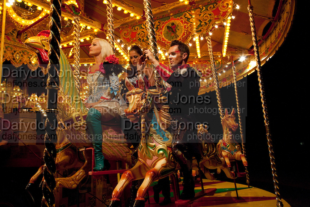 MAD HENS; HELEN CROSS; LAURA DJ; MATHEW JARRA; The Goodwood Ball. In aid of Gt. Ormond St. hospital. Goodwood House. 27 July 2011. <br /> <br />  , -DO NOT ARCHIVE-© Copyright Photograph by Dafydd Jones. 248 Clapham Rd. London SW9 0PZ. Tel 0207 820 0771. www.dafjones.com.