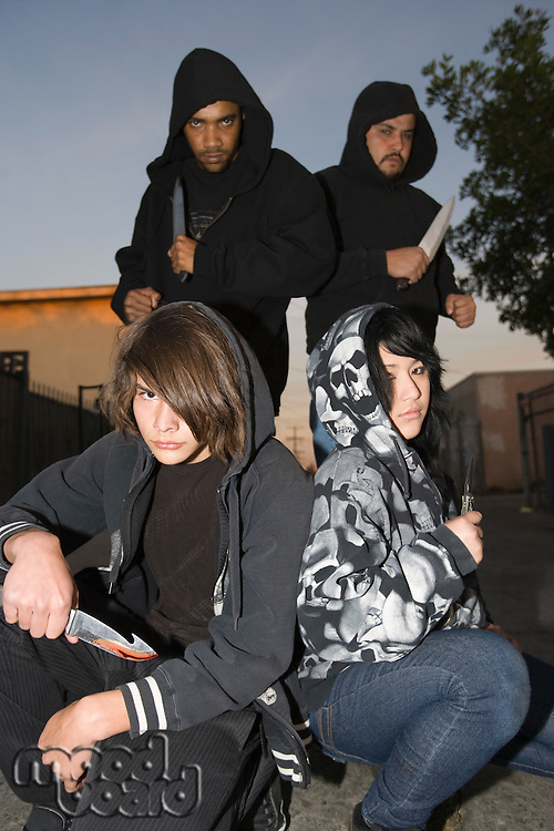 Group of young people posing with knives