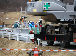 """Workers are seen behind large equipment in the town of Iitate, Fukushima Prefecture, Japan, March 7, 2015. The scenes from the towns and villages still abandoned four years after an earthquake triggered tsunami breached the defenses of the Fukushima Daiichi nuclear power plant, would make for the perfect backdrop for a post- apocalyptic Hollywood zombie movie, but the trouble would be that the levels of radiation in the area would be too dangerous for the cast and crew. The central government's maxim of """"Everything is under control"""" in and around the nuclear plant, has been a blatant lie since the disaster began to unfold on March 11, 2011, quickly escalating into the worst civilian nuclear crisis ever to happen, with twice the amount of radioactive materials being released into the environment than the Chernobyl disaster in 1986. EXPA Pictures © 2015, PhotoCredit: EXPA/ Photoshot/ Liu Tian<br /> <br /> *****ATTENTION - for AUT, SLO, CRO, SRB, BIH, MAZ only*****"""