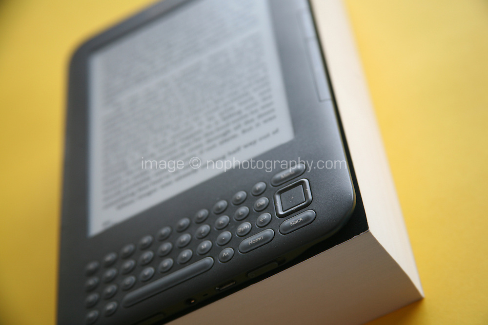 Kindle book placed on an actual book