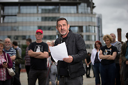 © Licensed to London News Pictures . 14/08/2016 . Manchester , UK . PAUL MASON reads at the commemoration . A memorial on the site of The Peterloo Massacre ( formerly St Peter's Field , now the Manchester Central Convention Centre ) , attended by Maxine Peake and Paul Mason . On 16th August 1819 , a rally calling for Parliamentary reform , improved workers rights and against poverty was brutally suppressed by sabre-wielding cavalrymen , resulting in the deaths of fifteen people and many hundreds injured . Photo credit : Joel Goodman/LNP