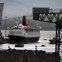 Tugs gather to help the QE2  on it's way  from  Ocean Terminal Greenock after its voyage to mark her 40th anniversary.Photograph David Cheskin.