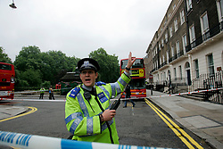UK ENGLAND LONDON 7JUL05 - A community support officer destures wildly amid cordoned-off buses in Russell Square in central London. At least two people have been killed and scores have been injured after at least seven blasts on the Underground network and a double-decker bus in London...jre/Photo by Jiri Rezac ..© Jiri Rezac 2005..Contact: +44 (0) 7050 110 417.Mobile:  +44 (0) 7801 337 683.Office:  +44 (0) 20 8968 9635..Email:   jiri@jirirezac.com.Web:    www.jirirezac.com..© All images Jiri Rezac 2005 - All rights reserved.