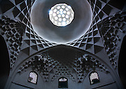 Stunning photographs reveal the beautiful ceilings in Iran's mosques, bazaars and public baths<br /> <br /> For the past few decades, restrictions on travel to Iran has meant the country has been largely shut off from the Western world, but as visa sanctions are lifted in the light of a landmark nuclear deal, the local tourism industry is hoping for a flurry of visitors.<br /> It's not hard to see why Iran is listed as one of the top travel destinations of 2016, with its rich culture and history. <br /> Among the standout aspects of the nation is its beautiful ancient architecture, with the cities and towns littered with ornate and eye-catching mosques, public baths and markets. <br /> And unlike many other countries - the roof is not an afterthought, with many ceilings built as the centrepiece to the building, with many of the tile designs showcasing a display of intricate geometric patterns that date back several centuries. <br /> French photographer Eric Lafforgue has travelled the country photographing the ceilings of indoor markets, mosques and bath houses. <br /> <br /> Photo shows: ceiling with its intricate and elaborate patterns in ganjali khan hammam, Central County, Kerman, Iran