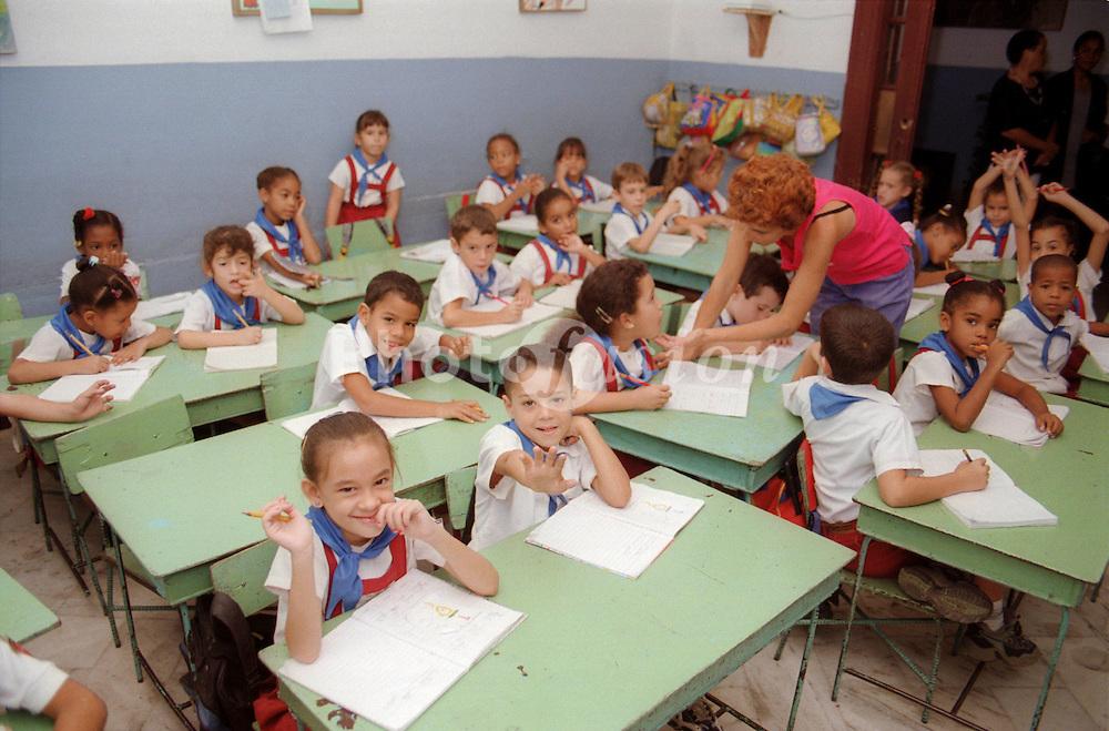 Children and teacher in a primary school classroom in Havana; Cuba,