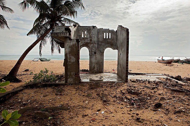 On the coasts, numbers of ruins stand as reminders of the disaster. Kalmunai, October 2009.