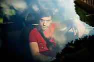 Milano, Italia - 7 giugno 2013. Christian Carella, fratello gemello di Daniele (vittima della furia omicida di Mada Kabodo), ritratto nella autovettura che avevano personalizzato insieme. Daniele,, come Christian, era molto appassionato di auto e motori. I due gemelli erano inseparabili.<br /> Ph. Roberto Salomone<br /> ITALY - A portrait of Christian Carella, twin brother of Daniele who was killed by Mada Kabodo. Christian is portrayed inside the car he and his brother cutomized.
