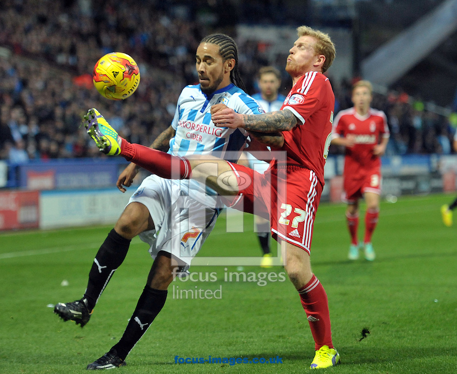 Sean Scannell of Huddersfield Town battles with Chris Burke of Nottingham Forest during the Sky Bet Championship match at the John Smiths Stadium, Huddersfield<br /> Picture by Graham Crowther/Focus Images Ltd +44 7763 140036<br /> 01/11/2014