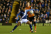 Birmingham City midfielder David Davis holds off Hull City midfielder Sam Clucas during the Sky Bet Championship match between Birmingham City and Hull City at St Andrews, Birmingham, England on 3 March 2016. Photo by Alan Franklin.