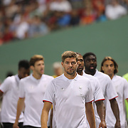 Steven Gerrard, Liverpool, walks to the bench with non playing team mates during the Liverpool Vs AS Roma friendly pre season football match at Fenway Park, Boston. USA. 23rd July 2014. Photo Tim Clayton