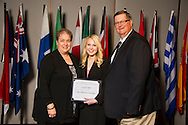 Eagle native Lauren Clark (right), an agribusiness major, receives an Oklahoma State University Dirk N. Webb Endowed Scholarship in CASNR from Dirk and Jana Webb (left) at the university's recent College of Agricultural Sciences and Natural Resources Scholarships and Awards Banquet. The scholarship is part of more than $1.4 million in scholarships and awards presented to CASNR students for the 2016-2017 academic year. (Photo by Todd Johnson)