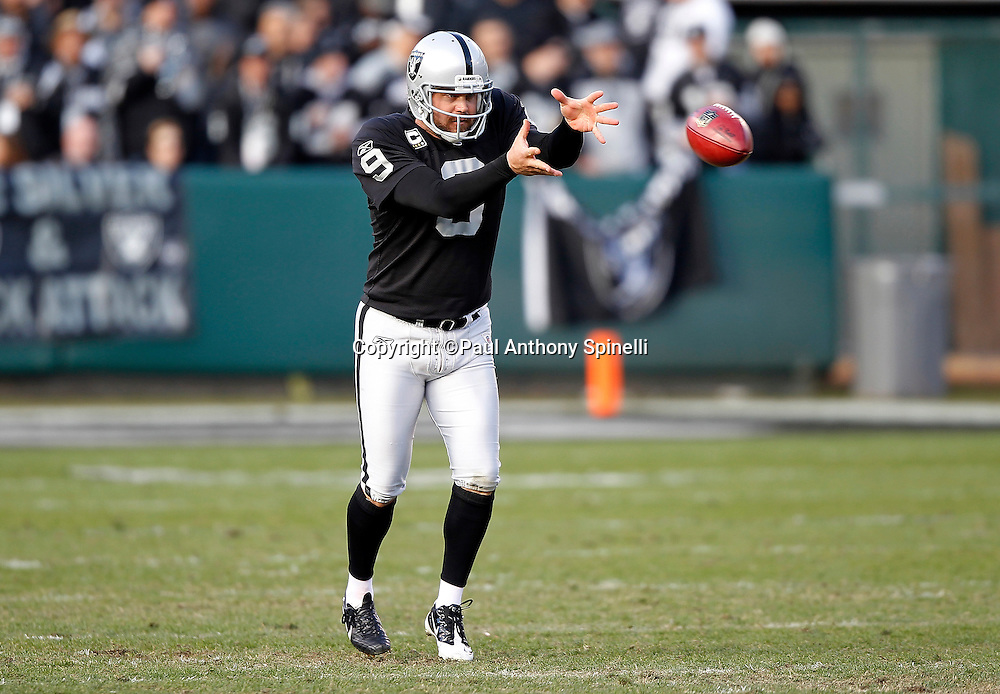 Oakland Raiders punter Shane Lechler (9) catches a long snap during the NFL week 15 football game against the Detroit Lions on Sunday, December 18, 2011 in Oakland, California. The Lions won the game 28-27. ©Paul Anthony Spinelli