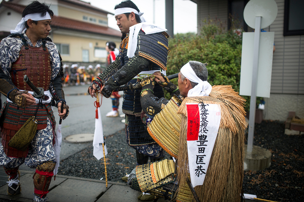 "MINAMISOMA, JAPAN - JULY 24 :  A samurai men prepares for the ritual ceremony during the ""Hon Matsuri"",  Soma Nomaoi festival at Minamisoma city on Sunday, July 24, 2016 in Fukushima Prefecture, Japan. ""Soma-Nomaoi"" is a three day traditional festival that recreates a samurai battle scene from more than 1,000 years ago. The festival has gathered more than thousands visitors as Fukushima still continues to recovery from the 2011 nuclear disaster, the samurai warriors battles for recovery of the area. (Photo: Richard Atrero de Guzman/NURPhoto)"
