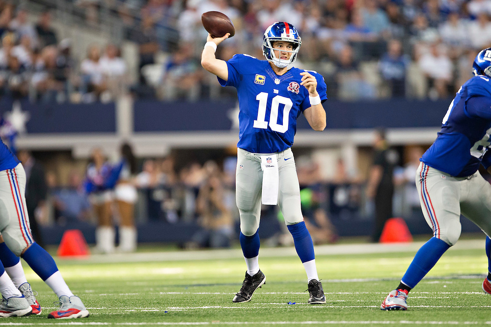 ARLINGTON, TX - OCTOBER 19:  Eli Manning #10 of the New York Giants throws a pass during a game against the Dallas Cowboys at AT&T Stadium on October 19, 2014 in Arlington, Texas.  The Cowboys defeated the Giants 31-21.  (Photo by Wesley Hitt/Getty Images) *** Local Caption *** Eli Manning