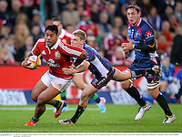 25 June 2013; Manu Tuilagi, British & Irish Lions, is tackled by Bryce Hegarty, Melbourne Rebels. British & Irish Lions Tour 2013, Melbourne Rebels v British & Irish Lions. AAMI Park, Olympic Boulevard, Melbourne, Australia. Picture credit: Stephen McCarthy / SPORTSFILE