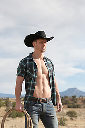 hot cowboy with an open shirt outdoors