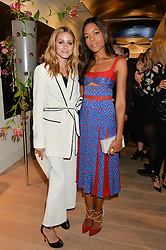 Left to right, OLIVIA PALERMO and NAOMIE HARRIS at the launch of the new Rimowa store at 153a New Bond Street, London on 29th June 2016.