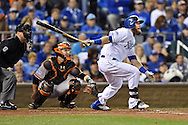 Oct 28, 2014; Kansas City, MO, USA; Kansas City Royals left fielder Alex Gordon hits a single against the San Francisco Giants in the second inning during game six of the 2014 World Series at Kauffman Stadium. Mandatory Credit: Peter G. Aiken-USA TODAY Sports