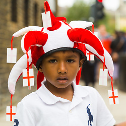 Young England cricket fan Gabriel, 4, from Bracknell makes his way to the stadium with his family as crowds flock to Lords Cricket Ground, the Home of Cricket to watch the ICC Cricket World Cup final between England and New Zealand. London, July 14 2019.