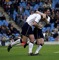 Photo. Glyn Thomas.<br /> Manchester City v Tottenham Hotspur. FA Cup fourth round. <br /> City of Manchester Stadium, Manchester. 25/01/2004.<br /> Spurs's Gary Doherty (L) is congratulated by Robbie Keane on scoring his side's equaliser.