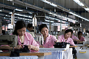 Factory workers sew in the Top Form factory.
