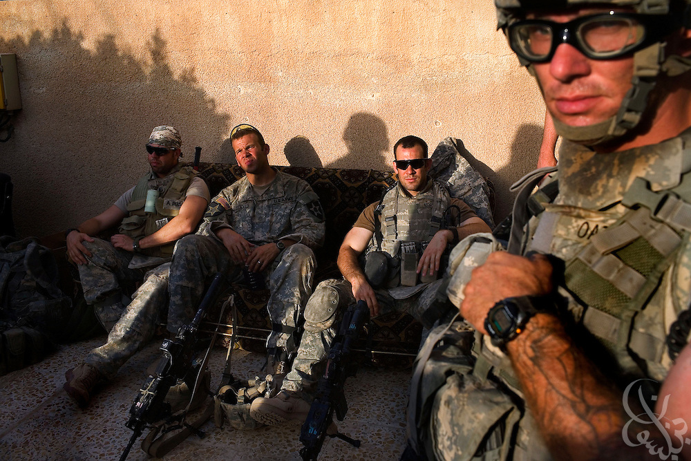 U.S. Army 1-23 Stryker soldiers wait for orders inside their stronghold position in an Iraqi compound during June 23, 2007 clearing operations in Baquba, Iraq. U.S. and Iraqi soldiers continuing to search house to house in Baquba are finding numerous abandoned buildings rigged with explosives left behind by fleeing Al Qaeda fighters.   ...