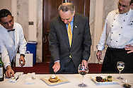 Sen. Charles Schumer, center, and executive chef Shannon Shaffer, right, inspect Hudson Valley apple pie, sour cream ice cream, aged cheese and honey, which will be served for the inaugural lunch, on Friday, January 4, 2013 in Washington, DC.