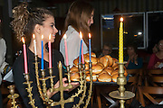 Hannukah with a menorah and Sufganyot