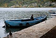 Monk in blue boat, Krka Franciscan Monastery, island of Visovac, Krka National Park, Croatia
