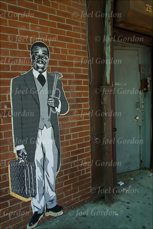 Louis Armstrong as street art on wall in the meat packing district in New York City. <br /> <br /> Street art can be a powerful platform for reaching people in public spaces.<br /> <br /> Traditional graffiti artists have primarily used free-hand aerosol paints to produce their works &quot;Street art&quot; encompasses many other media and techniques, including; Mosaic tiling, Murals, Stencil art, Sticker art, Wheat pasting, Wood blocking