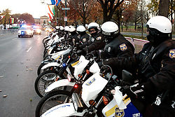 Police Officers on motorbikes line the Benjamin Franklin Parkway as the sun rises over the start location of the 2016 Philadelphia Marathon, on Benjamin Franklin Parkway, on Nov. 21, 2016.<br /> <br /> With the city of Philadelphia taking over organization the course, as well as start and finish locations are slightly different from past years. The winners for 2016 are, in the Mens race, Kimutai Cheruiyot in 2:15:53, and Taylor Ward in the Womens race in 2:36:25